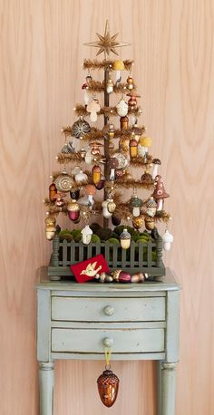 with Matthew Mead: King of the Forest. like the fence at the base of the tree Potted Christmas Trees, Christmas Tree Art, Tabletop Christmas Tree, Beautiful Christmas Trees, Merry Little Christmas, Victorian Christmas, Vintage Christmas Ornaments, Holiday Tree, Christmas Love