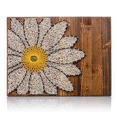"Create this wonderful Daisy String Art Kit!  Great gift idea for those crafters you know.  Or do-it-yourself for a friend.  The DIY Kit's 16"" by 12"" wood board is HAND sanded and HAND stained dark walnut.  Every kit includes only the highest quality embroidery floss. And there is plenty of extra string necessary to complete"