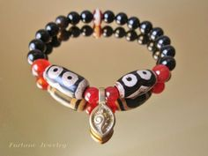 $49.00 Harmony Twin Tibetan 3 Eyed Protection Dzi Bead Bracelet with 8mm Black Agate Beads and Tibetan Brass Malas Counter Clips - Fortune Feng Shui Jewelry by Fortune Jewelry & Healing Beauty, http://www.amazon.com/dp/B00C45XZ1A/ref=cm_sw_r_pi_dp_4guLrb0HEYVYF