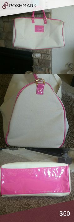 Victoria secret travel tote NWOT Victoria Secret beige. canvas like material with hot pink trim.  It has a zipper clouser.  The strap can be worn on your shoulder or carried by the handles.  Width is 21 by 11 inch high. Perfect for weekends or beach. Victoria's Secret Bags Travel Bags