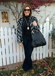 A black and white, Chevron print, faux fur jacket with flares makes a super chic look! http://akstylemyway.blogspot.com/
