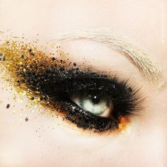 Black and gold glitter eye make up