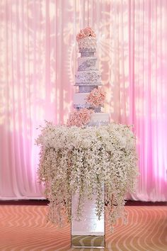 For sweet savings, repurpose the flowers from your ceremony for your cake table.