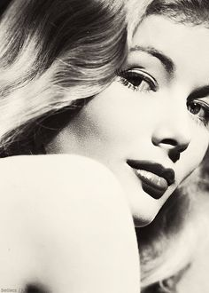 Veronica Lake was an American film, stage and television actress. Lake won both popular and critical acclaim, most notably for her role in Sullivan's Travels and for her femme fatale roles in film noirs with Alan Ladd, during the 1940s. She was also well known for her peek-a-boo hairstyle.