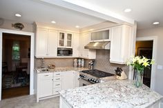 Loads of storage and Artistic Touches, Another View - traditional - kitchen - other metro - Kitchen + Bath Design + Construction, LLC