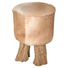 Teak wood stool with a textured cowhide seat.Product: StoolConstruction Material: Natural teak wood and cowhideColor: TanFeatures: Master craftmanshipElegant and trendyAs alluring as it is durable    Made by artisans in Indonesia Dimensions: 17 H x 12.6 Diameter