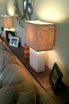 Behind Sofa Shelf. Piece of wood stained & varnished. Attach to wall with 2 L racks.