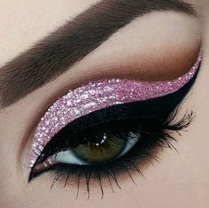 Love this elegant winged look. The wave of pink glitter and the bold black gives her that dramatic look and accentuates her eyes..