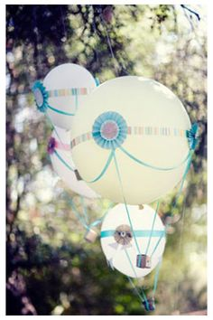What fun!! Balloons carefully decorated into hot air balloons! I could see a photo shoot with something like this!