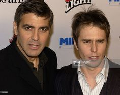 Actor Sam Rockwell (R) and actor/director George Clooney attend the premiere of the film 'Confessions Of A Dangerous Mind' on December 11, 2002 in Westwood, California.