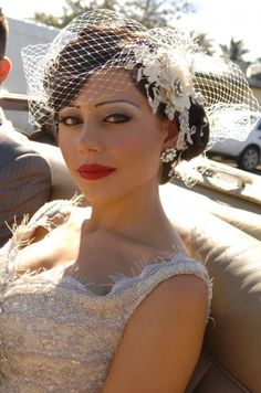 "Gorgeous!! This is essentially the ""idea"" of the look I want, with the birdcage (a more simple one, though) and the red lips, with a fascinator at the side of the hair."