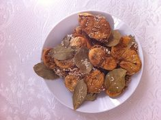 dried figs with sesame seeds, almonds and bay leaves