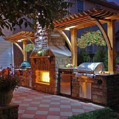 Image of Chic Outdoor Grill Kitchen Design with Travertine Cladding for Outdoor Kitchen Fireplace Ideas and Unfinished Wooden Outdoor Pergolas on Checkerboard Ceramic Tile Floor