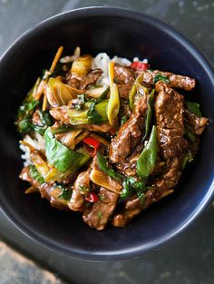 Easy Beef Stir Fry! With ginger and scallions and a honey soy marinade. Cooks up in minutes! On SimplyRecipes.com