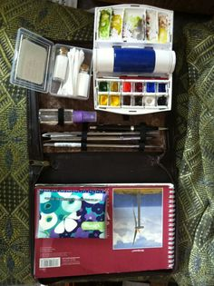 I made this watercolour travel kit today. Used an old day timer. Removed the binder rings and business card pockets before sewing an insert and gluing it in. Holds all I need.