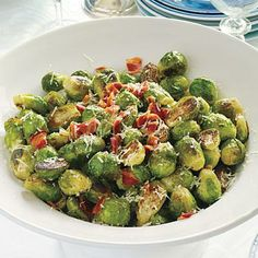 Brussels Sprouts with Pancetta - Perfectly Paired Holiday Sides - Southernliving. Pancetta and Parmesan cheese add salty flavor to the roasted Brussels sprouts. You can substitute bacon for the pancetta. Recipe: Brussels Sprouts with Pancetta Best Thanksgiving Side Dishes, Holiday Side Dishes, Thanksgiving Recipes, Holiday Recipes, Christmas Recipes, Hosting Thanksgiving, Christmas Snacks, Thanksgiving Feast, Holiday Treats