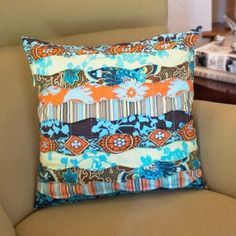 Sew this easy pillow top using strips of your favorite leftover fabrics.