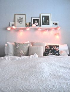 Shelf Above bed with cute lights instead of headboard