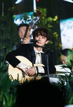 Every fangirl/boy needs a Chanyeol playing a guitar