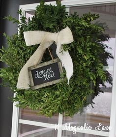 Really like the simplicity. Embellish a Home Depot boxwood wreath from 11 Magnolia Lane.