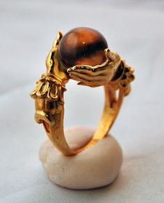 """Come see our unique and bizarre offerings, including the famous """"Nocturne""""  ring featuring dainty bats and sparkling gemstones. See Moira, a ring fit  for a goddess.  Jewelry, apparel, art and more. Feast your eyes on the strange and unusual."""