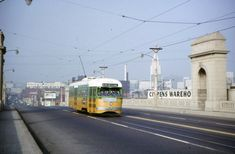 A Los Angeles Metropolitan Transit Authority P Line Yellow Car crosses the Los Angeles River on the First Street Bridge, circa 1960. Courtesy of the Metro Transportation Library and Archive.