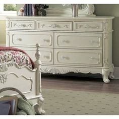 The Cinderella Collection is your little child's dream. The Victorian styling incorporates floral motif hardware, ecru painted finish and traditional carving details that will create the feeling of a room worth of a fairy tale princess.