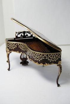 Every house looks better with a piano, including a dollhouse! This is a {beautifully embellished} mini piano made just for mini homes | Grand Piano made by Ken