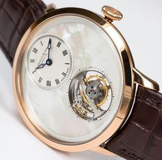 Arnold & Son UTTE. Ultra thin tourbillon with white mother of pearl dail.