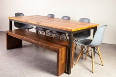 Industrial Steel Base Table in reclaimed fir, mitered corner bench and grey Dwell chairs