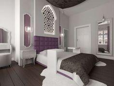 Sypialnia z wyraźnie ciemną podłogą oraz jasnymi ścianami. Dodatkowym kolorem wprowadzonym we wnętrze jest fiolet, który dodaje mu eleganckiego charakteru typu Glamour.