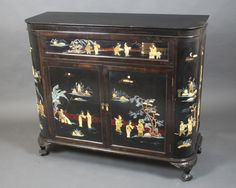 "Lot 859,	A 1930's Chinese black lacquered and inlaid hard stone cocktail cabinet, the hinged lid revealing a fitted interior, having a cupboard to the side and front enclosed by panelled doors, raised on carved supports 42""h x 48""w x 17""d sold for £320"