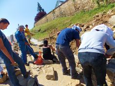 Volunteers renovate a rock wall in France. Volunteers Around The World, Rock Wall, Around The Worlds, Peace, Country, Rural Area, Country Music, Sobriety, World