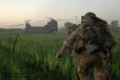Soldiers of 1st Battalion the Coldstream Guards are pictured running to a Chinook Helicopter waiting to extract them, following operations in Afghanistan.