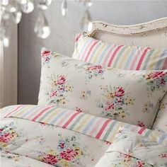 Cath Kidston stripe and floral bedding - I'd love some of these candy stripe sheets for my bed - they remind me of my childhood!