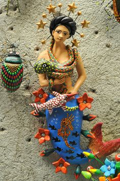 Lovely mermaid surrounded by her fish friiends. She is the creation of ceramic artist Concepcion Aguilar of Ocotlan, Oaxaca Mexican Crafts, Mexican Folk Art, Mexican Style, Mexican Artists, Chicano Tattoos, Mexican Designs, Native American History, American Symbols, Merfolk