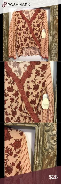 """NEW LISTING NWT Altar'd State floral hi lo top❤️❤️ NEW LISTING NWT Altar'd State floral hi lo top. The top has a flowy sleeve as shown in last pic. The top is approximately 22"""" in front and approximately 25"""" from top of shoulder to bottom of back hem. The top is 100 percent rayon and hand wash Altar'd State Tops Blouses"""
