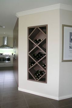 Now this is a great use of space! A plain corner wall was upgraded with custom built-in wine shelves! What do you think of this idea?