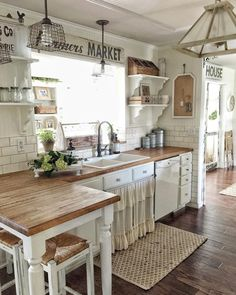 Farmhouse kitchen with wood countertops.