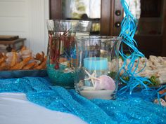 sand and shell centerpieces and mini aquariums in vases