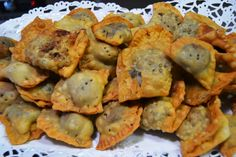 In Abruzzo it isn't Christmas without Caggionetti. There are many versions according to the area and your tastes. In this version caggionetti are filled with chickpeas, bitter cacao, sugar, honey, mosto cotto (cooked wine), walnuts, almonds, peel of orange and ground cinnamon