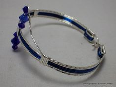 Jo-Bobs Fashion Jewelry - Blue Accented Silver filled Wire Bracelet, $29.95 (http://www.jo-n-bobsfashionjewelry.com/blue-accented-silver-filled-wire-bracelet/)