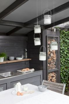 Love the wood storage in this outdoor kitchen by Langius Design Outdoor Rooms, Outdoor Gardens, Outdoor Living, Outdoor Kitchen Design, Kitchen Decor, Nice Kitchen, Scandinavian Garden, Summer Kitchen, Home And Deco