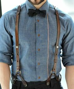 blue shirt/leather suspenders