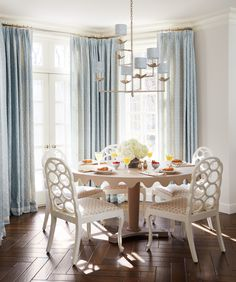 Sunny Lake Forest Breakfast Room with Elkins chairs and custom dining table