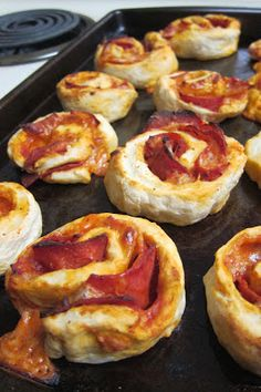 Recipe   Pepperoni Pizza Pinwheels ~ Your favorite guys will love these! Disguised as sophisticated pinwheels, they're really just hand-held pizzas. Begin with bread dough which is layered with pizza sauce, pepperoni and cheese, and then rolled and sliced... #appetizer #snacks