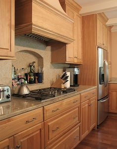 honey oak kitchen cabinets with black countertops |  pearl or