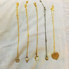 "FIVE Juicy Couture Pendant Necklaces Five rare juicy couture necklaces, not sold online & from 2005. Save & buy all five for 65 dollars. Normally each is listed at $15-$20 separately! Comment if you'd like to make a listing of one. All of them are gently loved &in good condition. Comes with the crown pendant necklace, the engagement ring pendant necklace, wishbone pendant necklace that says ""I wish for couture"",  jeweled heart pendant necklace and a gold heart pendant necklace that is…"