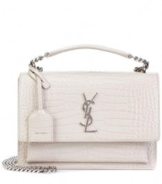 487f038213 Add a classic style to your edit with Saint Laurent s Medium Sunset  Monogram shoulder bag. Crafted in Italy from crocodile-embossed white  leather