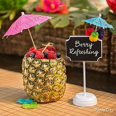A tropical bowl bursting with fruit! Chop the top off of a pineapple, scoop out the insides and fill with bright berries. Finish by inserting a bamboo pick and a giant umbrella.